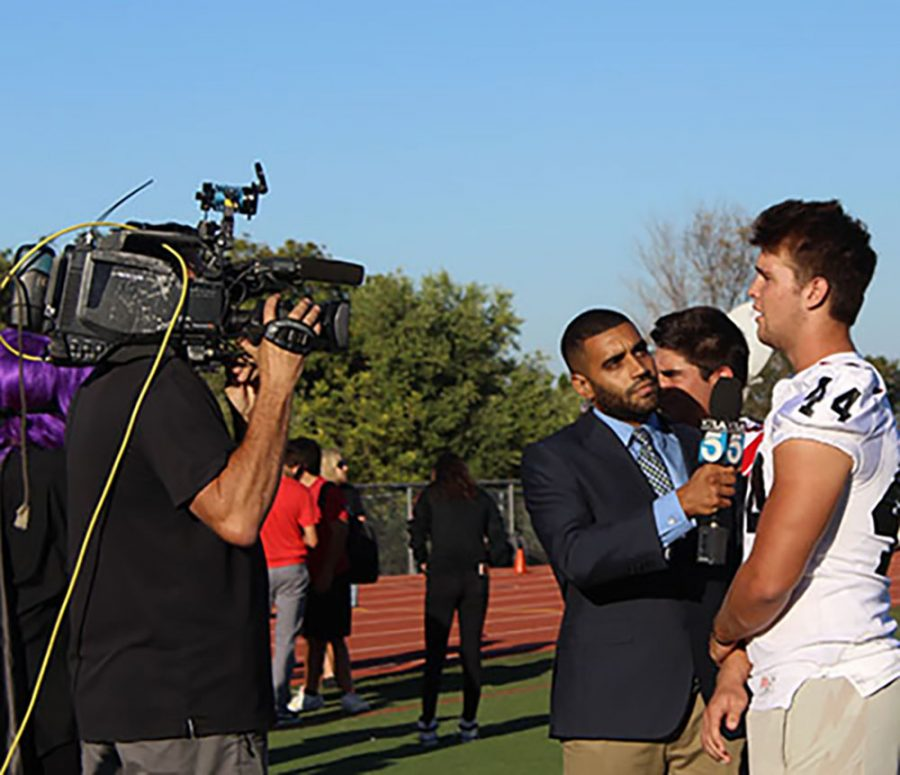 KTLA reporter Avi Bernard interviews football players Tre Gonzalez and Shane Irwin.