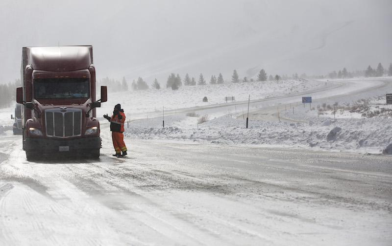 Transportation worker Mark Reistetter gives a Reno, Nev.-bound truck driver his options at a checkpoint closing all northbound traffic at US 395 and state route 203 near Mammoth Lakes, Calif., on Tuesday, Jan. 10, 2017. (Brian van der Brug/Los Angeles Times/TNS)