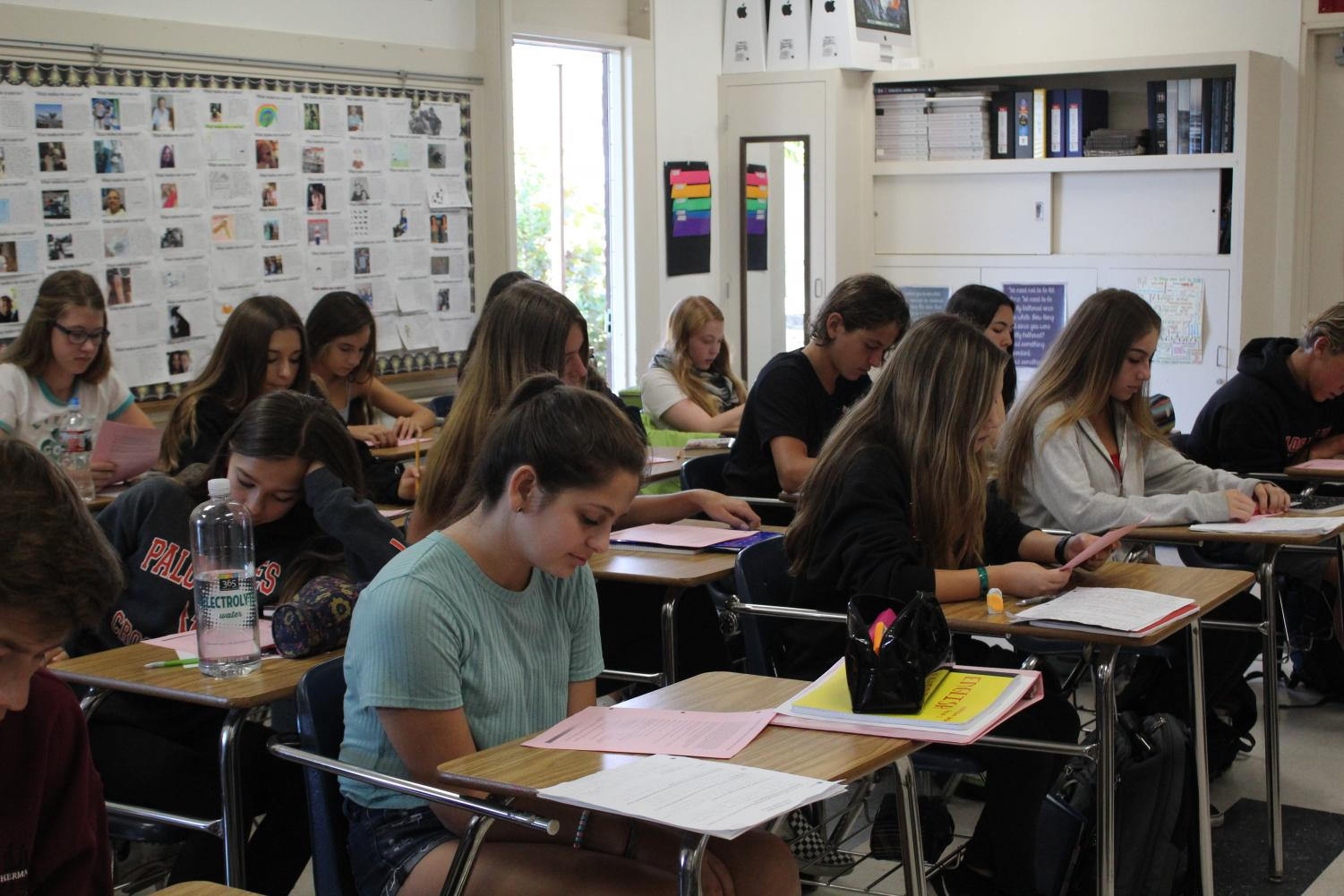 Students work in a crowded classroom, which appears to be the norm. Here, Ms. Ruiz's English 1 Honors class works in a room of 39 students.