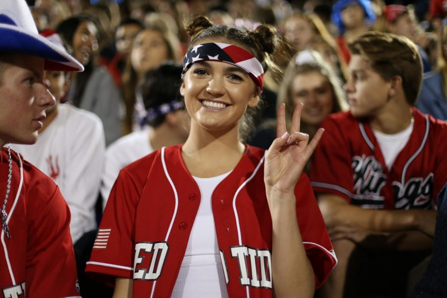 Nicole Halverson helps to lead the Red Tide section at a football game.