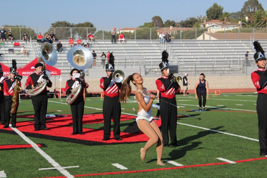 Molly Tamir performs with the marching band at the homecoming halftime show.