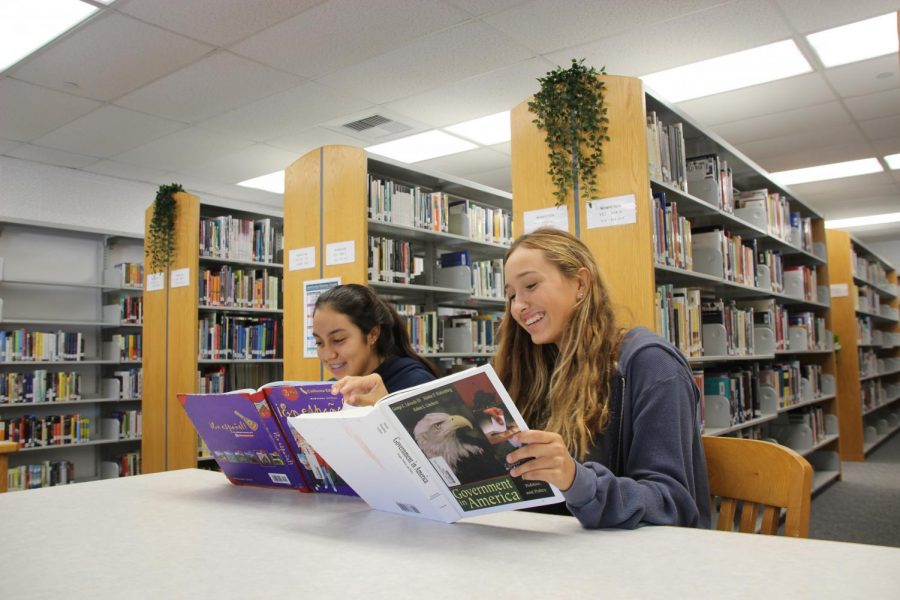 Juniors Shannon Aguilar and Ryan Ammann prepare for upcoming exams in the library.