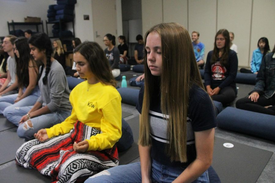 Students practice meditation in Mindfulness class.