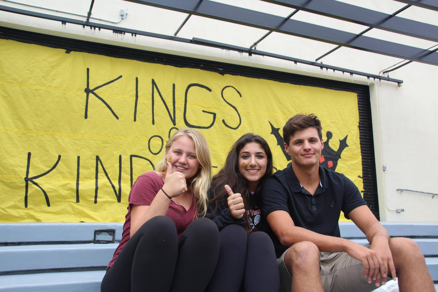 Three students pose amidst Yellow Ribbon Week festivities. (Photo by McKinley Pieper)